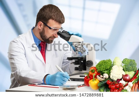 Food quality control expert inspecting specimens of groceries in the laboratory #1472889881