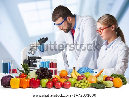 Food quality control expert inspecting specimens of groceries in the laboratory #1472891030