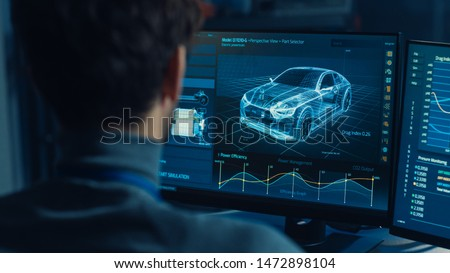 Professional Automotive Graphic Designer is Working on 3D CAD Software Rendering Electric Concept Car and Calculating its Efficiency in a High Tech Innovative Laboratory with a Prototype. #1472898104