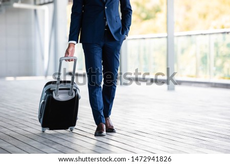 cropped view of businessman in formal wear holding suitcase  #1472941826