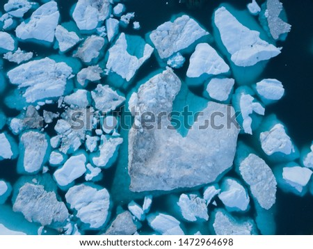 Icebergs drone aerial image top view - Climate Change and Global Warming. Icebergs from melting glacier in icefjord in Ilulissat, Greenland. Arctic nature ice landscape in Unesco World Heritage Site. #1472964698