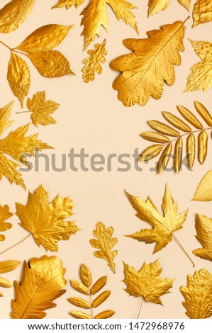 Flat lay creative autumn composition. Frame from Golden leaves on beige background top view copy space. Fall concept. Autumn background. Minimal concept idea, floral design