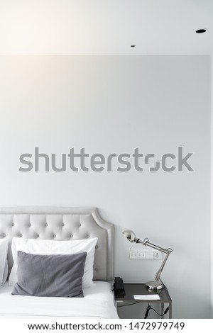 Cozy bedroom corner in minimal modern style with empty cool gray painted wall in the background / in terior concept / background for advertising. #1472979749