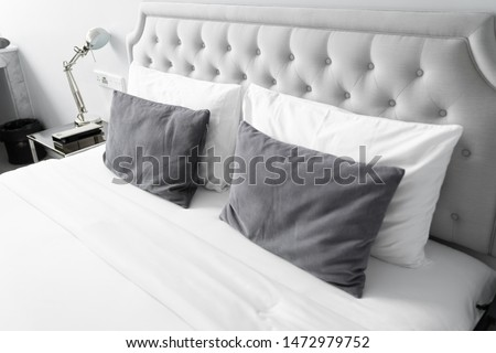 Cozy bedroom corner in minimal modern style with empty cool gray painted wall in the background / in terior concept / background for advertising. #1472979752