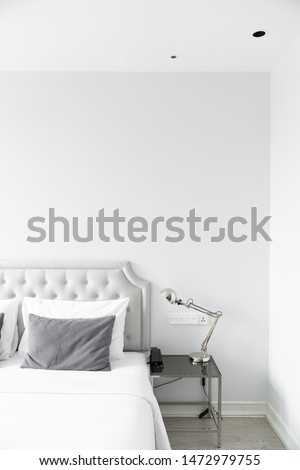Cozy bedroom corner in minimal modern style with empty cool gray painted wall in the background / in terior concept / background for advertising. #1472979755