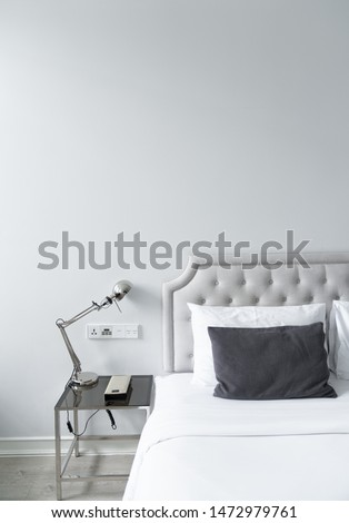 Cozy bedroom corner in minimal modern style with empty cool gray painted wall in the background / in terior concept / background for advertising. #1472979761