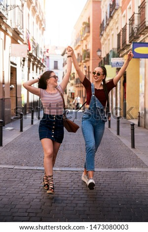 Beautiful women friends having fun in Madrid. Friendship concept #1473080003