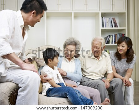 three-generation asian family talking in living room. #147309200
