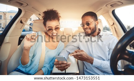 Young couple driving car and using digital map on smartphone, panorama #1473153551