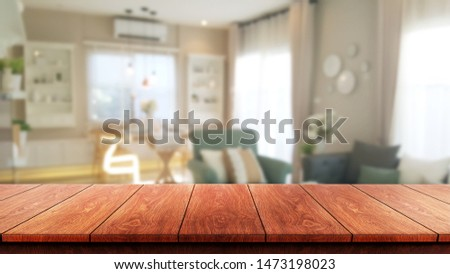 Wood table in modern home room interior with empty copy space on the table for product display mockup. Furniture design and home decoration concept. #1473198023