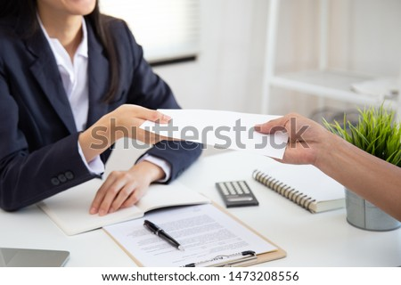 Close up view of Young Asian business woman receiving salary or bonus money from boss or manager at office happily. #1473208556