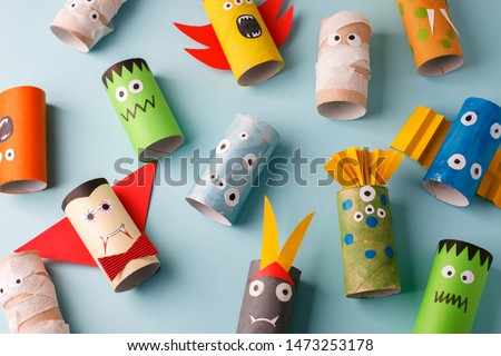 halloween and decoration concept - monsters from toilet paper roll tube. Simple diy creative idea. Eco-friendly reuse recycle decor, kindergarten paper craft #1473253178