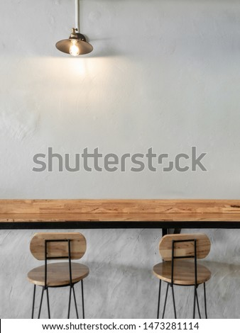 Empty on people. Coffee shop interior design With chairs, vintage light bulb and white walls. #1473281114