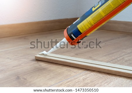 glue for fitting of skirting or washboard, laminate floor, renovation of the house #1473350510