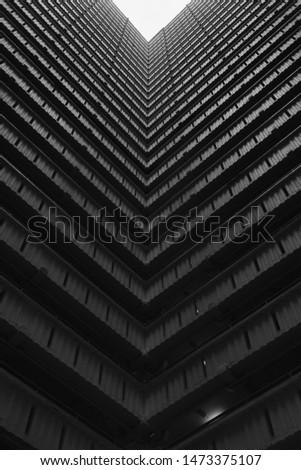 Hong Kong, China - 24 June 2019: Bottoms up view of the cascading corridors opening up to the sky at an old public housing estate in Ping Shek, Kwun Tong District, Kowloon, Hong Kong.  #1473375107
