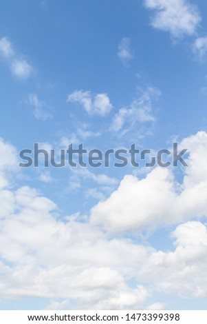 White cumulus clouds on a blue sky. Royalty-Free Stock Photo #1473399398