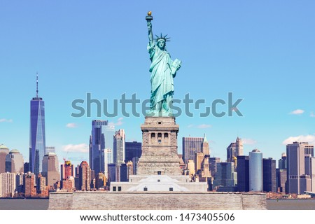 The Statue of Liberty with the One world Trade building center over hudson river and New York cityscape background, Landmarks of lower manhattan New York city. #1473405506