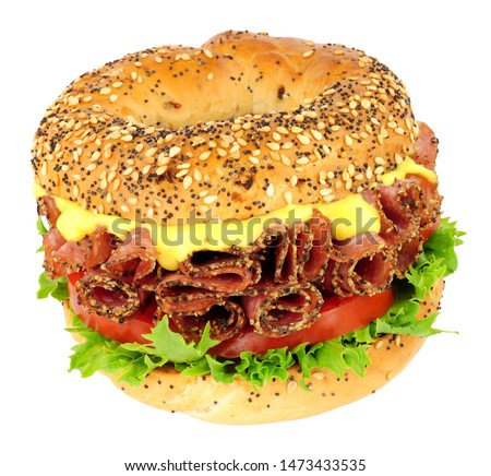 Peppered salami and salad bagel sandwich isolated on a white background #1473433535