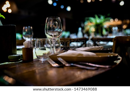 Luxury table settings for fine dining with and glassware, beautiful blurred  background. For events, weddings.  Preparation for holiday   props for weddings, birthdays, and celebrations. #1473469088