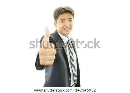 Happy business man showing thumbs up sign #147346952
