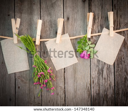 medicine herbs and paper attach to rope with clothes pins on wooden background