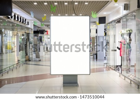 Blank  advertising sign mockup  inside shopping center