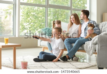 Happy family watching TV at home #1473540665