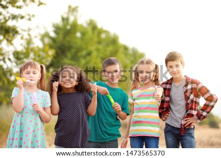 Portrait of cute little children showing thumb-up gesture outdoors #1473565370
