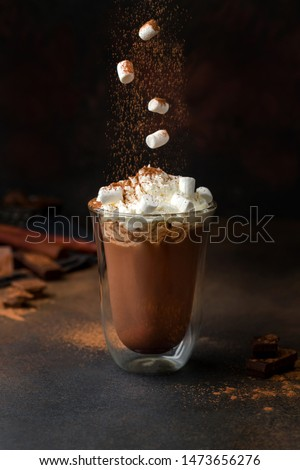 hot chocolate with cream and marshmallow in a clear glass. marshmallow falling into cacao. #1473656276