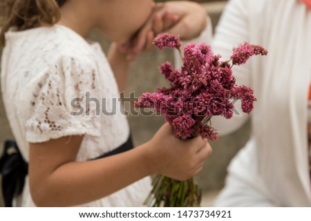 celebrate the victim feast of the elders on the religious holidays.happy mother and teachers day.kiss the mum hand.