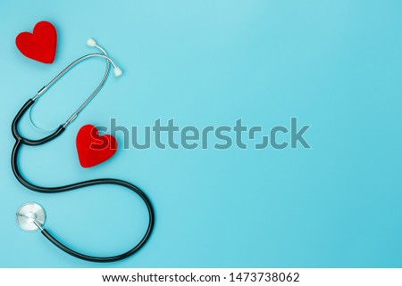Table top view aerial image of accessories healthcare & medical with Valentines day background concept.telescope with colorful heart shape on blue paper.Flat lay items for doctor using treat patient.