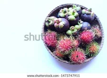 rambutan and mangosteen a basket on white background #1473747911
