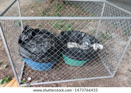 Trash in a steel cage #1473766433
