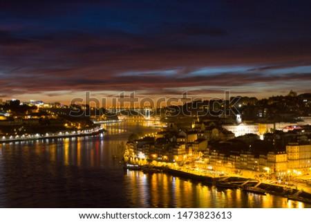 PORTO, PORTUGAL - SEPTEMBER - 11, 2016: Old town of Porto and the Douro River at night in Porto, Portugal. #1473823613