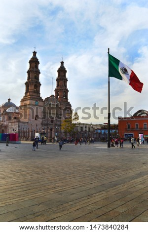 Acuascalientes / Mexico - February 02, 2019: Cathedral and flag of Mexico in downtown Aguascalientes Mexico #1473840284