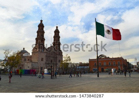 Acuascalientes / Mexico - February 02, 2019: Cathedral and flag of Mexico in downtown Aguascalientes Mexico #1473840287