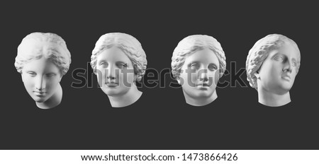 Four gypsum copy of ancient statue Venus head isolated on black background. Plaster sculpture woman face. #1473866426