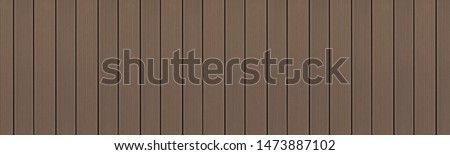 Top view of WPC in dark oak color. WPC: Wood-Plastic Composites are wood fiber and thermoplastic such as PE, PP, PVC, or PLA. A WPC decking are stylish and enrich the outdoor living #1473887102