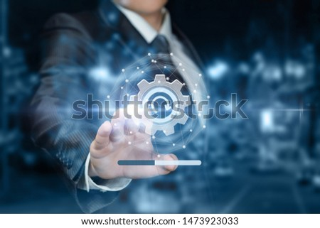 The concept of upgrading or rebooting the system. The businessman clicks on the refresh icon. Royalty-Free Stock Photo #1473923033
