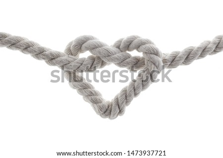 heart shape knot of rope isolated on white background Royalty-Free Stock Photo #1473937721