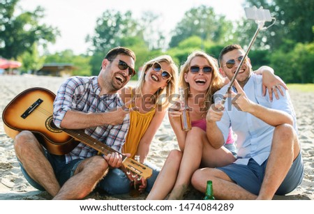 Summer time. Young couples enjoys in a good mood on the beach. Lifestyle, vacation concept #1474084289