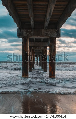 beach under bridge with blue sky #1474100414