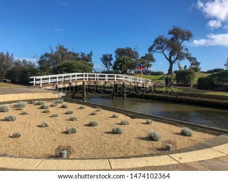 A Bridge over a river with plantation #1474102364