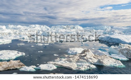 Greenland Iceberg landscape of Ilulissat icefjord with giant icebergs. Icebergs from melting glacier. Arctic nature. #1474118690