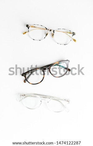Three Pairs of Tortoise Shell Glasses on White Background, Isolated Glasses #1474122287