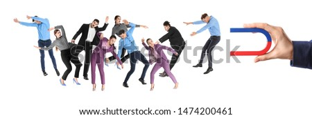 Woman attracting people with magnet on white background, closeup. Marketing concept #1474200461