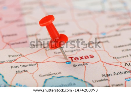 Red clerical needle on a map of USA, Texas and the capital Texan. Close up map of Texas with red tack, United States map pin USA #1474208993