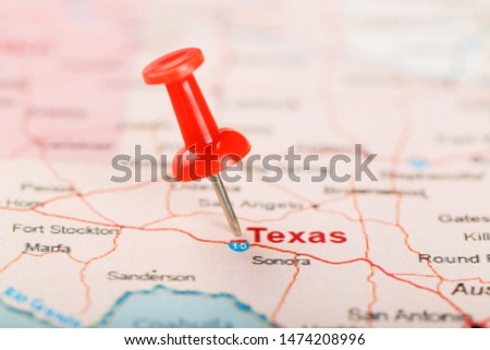 Red clerical needle on a map of USA, Texas and the capital Texan. Close up map of Texas with red tack, United States map pin USA #1474208996