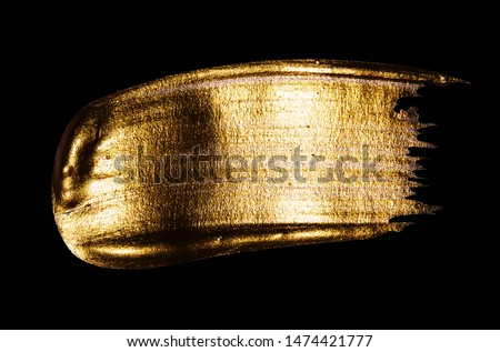 Creative brushstrokes of gold paint isolated on a black background. Gold paint texture.Acrylic gold paint. Smears of cosmetics, blush, highlighter, eye shadow, lipstick. #1474421777