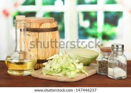 Green cabbage, oil, spices on cutting board, on bright background #147446237